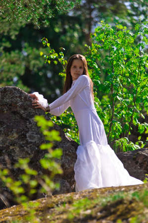 gentle dream vacation: girl in white dress in the woods Stock Photo