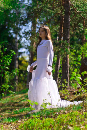 girl in white dress in the woods Stock Photo - 10324630