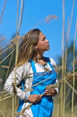 girl in ethnic dress in the park Stock Photo - 12233404