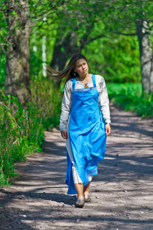 girl in ethnic dress in the park photo