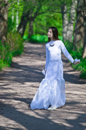 girl in white dress in the park Stock Photo - 10324620