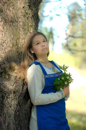 girl in ethnic dress in the park photo