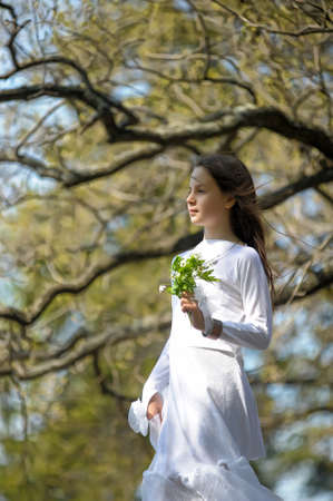 romantic girl with a bouquet in his hand looking into the distance photo
