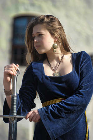 medieval sword: Young girl in medieval dress with  sword Stock Photo