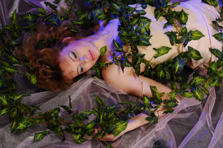 young woman lying with ivy photo