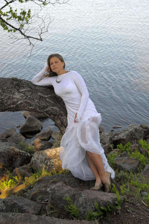 woman in a white dress at lake photo