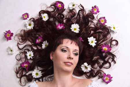 woman with flowers in her hair photo