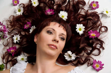 woman with flowers in her hair Stock Photo - 10221790