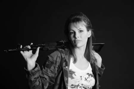 croft: beautiful young woman with a gun Stock Photo