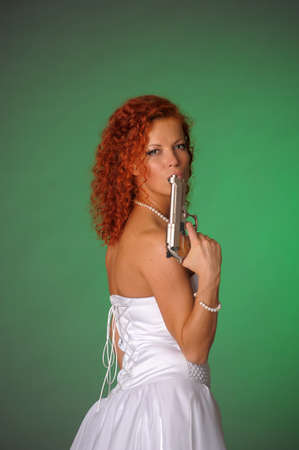 beautiful bride with a gun Stock Photo - 10566547
