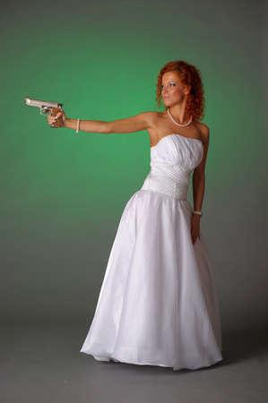 beautiful bride with a gun photo