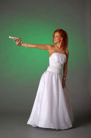 beautiful bride with a gun Stock Photo - 10566542