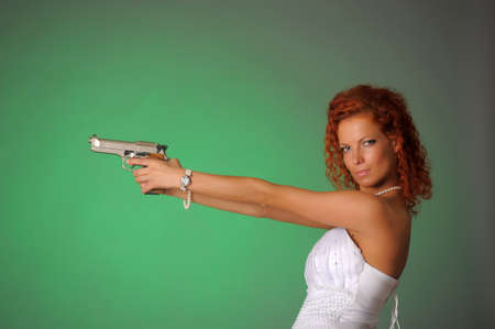 beautiful bride with a gun Stock Photo - 10566537