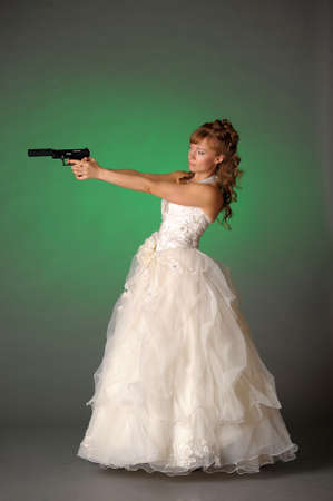 aiming: beautiful bride with a gun