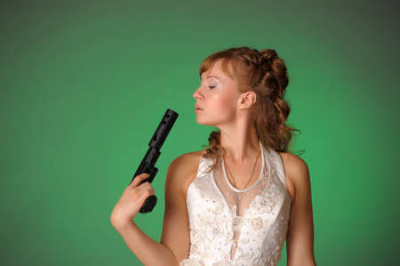 beautiful bride with a gun Stock Photo - 10566544