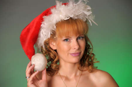 blonde young woman in santa hat photo