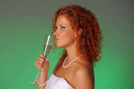 the bride with a glass of champagne in the studio Stock Photo - 10575477