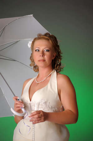 woman in a white dress with umbrella photo