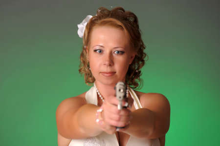 beautiful bride with a gun Stock Photo - 10575476
