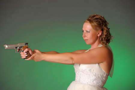 beautiful bride with a gun Stock Photo - 10575479