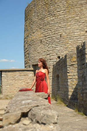Renaissance woman in front of Castle  photo