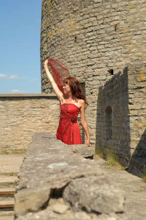 the girl walking on the wall of a medieval fortress photo