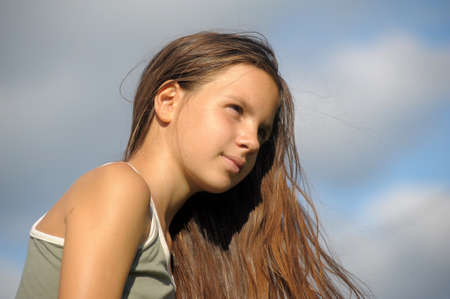 eyeing: The girl the teenager with long beautiful hair  Stock Photo