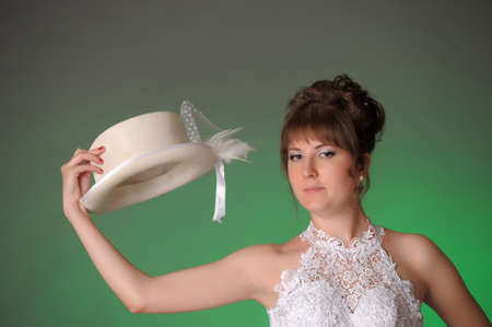 bride with white hat in his hand photo