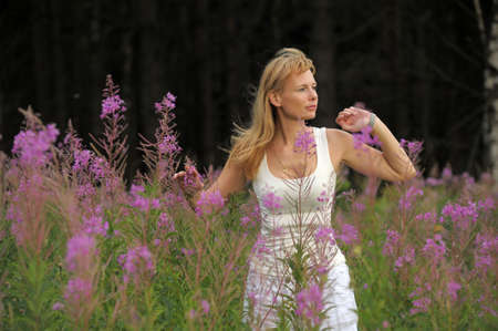 girl among the flowers in the field Stock Photo - 10490788