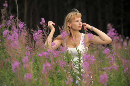 girl among the flowers in the field Stock Photo - 10491352