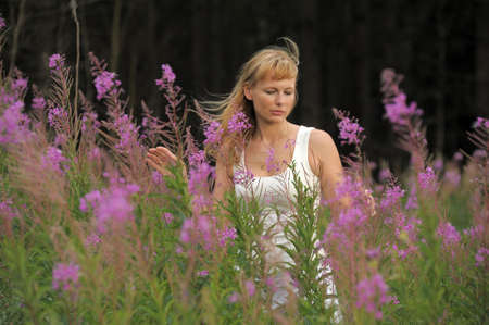 girl among the flowers in the field Stock Photo - 10491354