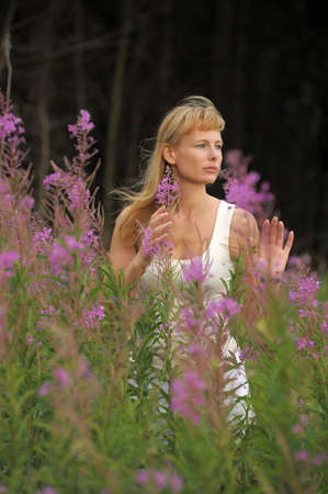 girl among the flowers in the field Stock Photo - 10491350