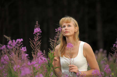 girl among the flowers in the field Stock Photo - 10491344