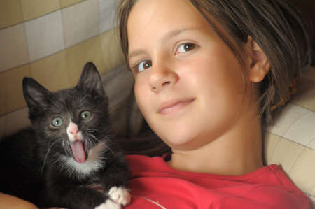 adore: teen girl with a kitten Stock Photo