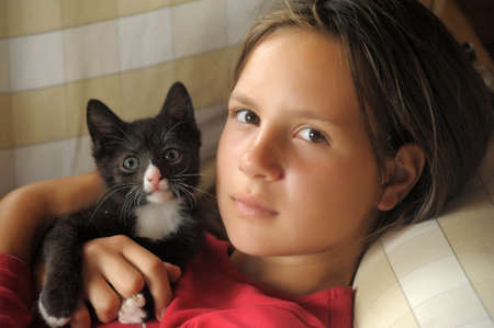 teen girl with a kitten photo