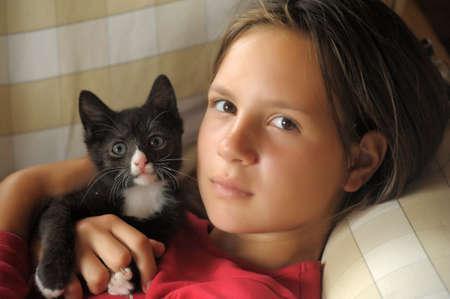 teen girl with a kitten photo