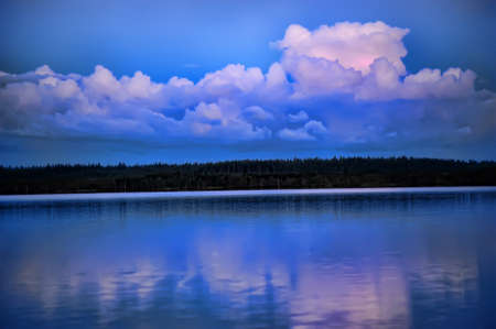 Evening clouds over lake photo