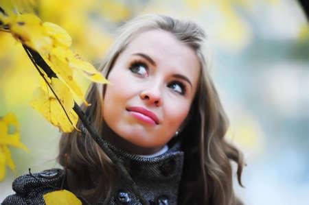 girl in autumn park photo