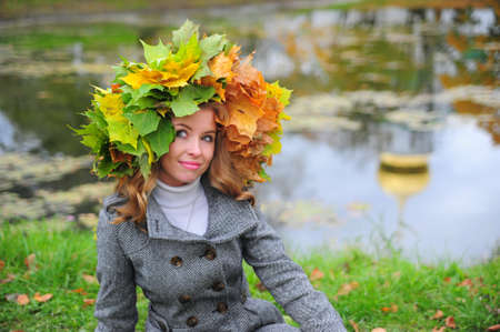girl in a wreath of autumn leaves photo