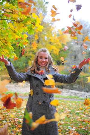 Girl throwing leaves Stock Photo - 10604147