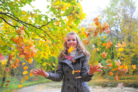 Girl throwing leaves Stock Photo - 10604148