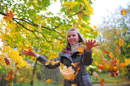 Girl throwing leaves Stock Photo - 10564195