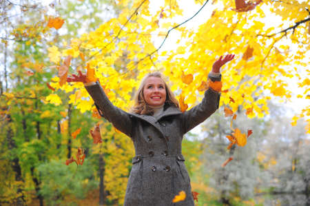 Girl throwing leaves Stock Photo - 10564194