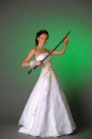 bride with a sword in his hand  photo