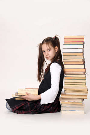 sexy schoolgirl: girl with a big stack of books