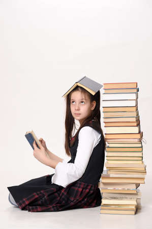 girl with a big stack of books photo