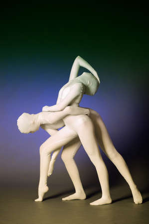 female form: two abstract figures dancing in a white