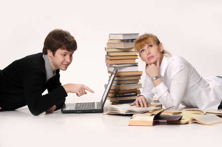 young man with laptop and woman with the books photo