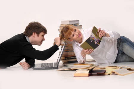 young man with laptop and woman with the books Stock Photo - 10773524
