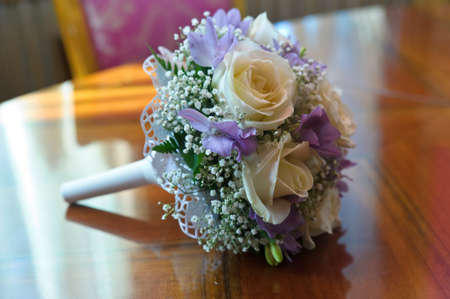 white lilac wedding bouquet on the table photo
